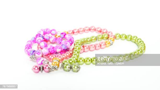 bead necklace on white background - bead stock pictures, royalty-free photos & images