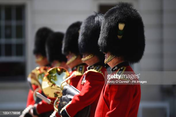A bead of sweat falls from a member of The Queen's Guard as he takes part in the Changing the Guard ceremony at Wellington Barracks in London as the...