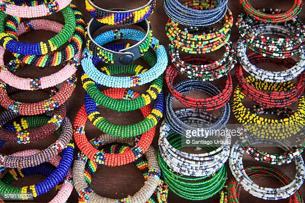 beaded bracelets for sale by maasai jewellers - jewellery products stock photos and pictures