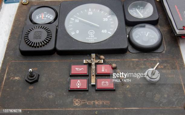 Beads and a Cross are pictured in the Wheel house of the ferry 'St Davog' which would usually take pilgrims to St Patrick's Purgatory on Lough Derg...