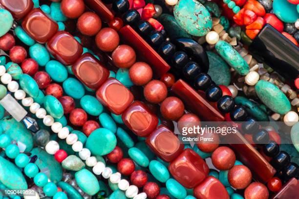 beads and bracelets from oaxaca - perlenschnur stock-fotos und bilder