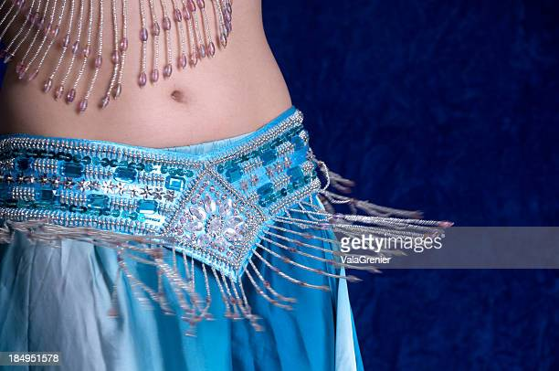 beads flying on bellydancers belt. - belly dancing stock photos and pictures