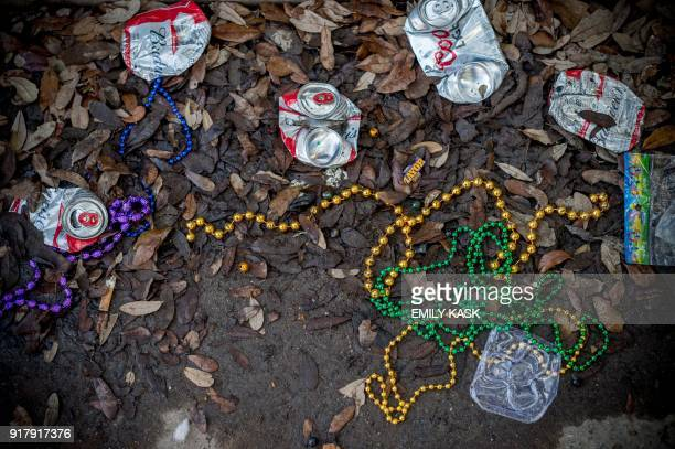 Beads lie on a sidewalk as the Zulu Parade runs through New Orleans on Mardi Gras February 13 2018 / AFP PHOTO / 00059360A / Emily Kask