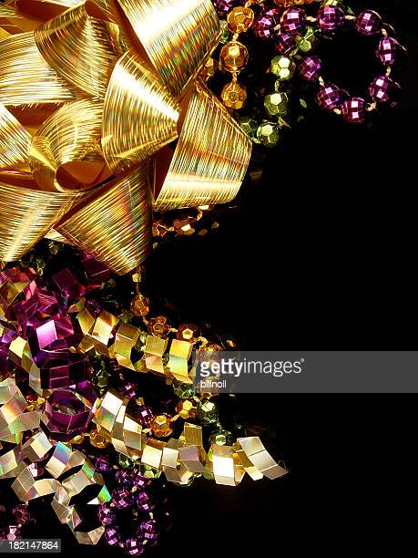beads, ribbons and bows - mardi gras flashing stock photos and pictures