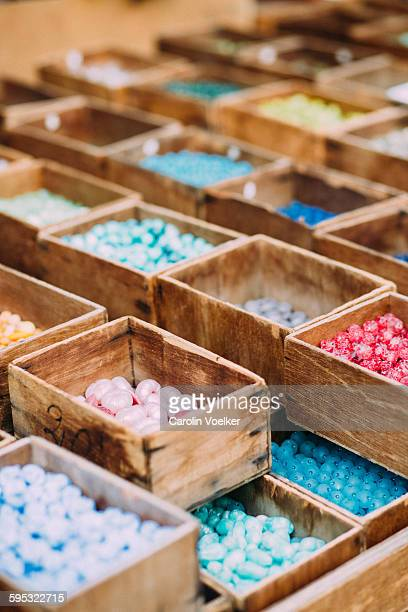 Beads sorted in wooden boxes