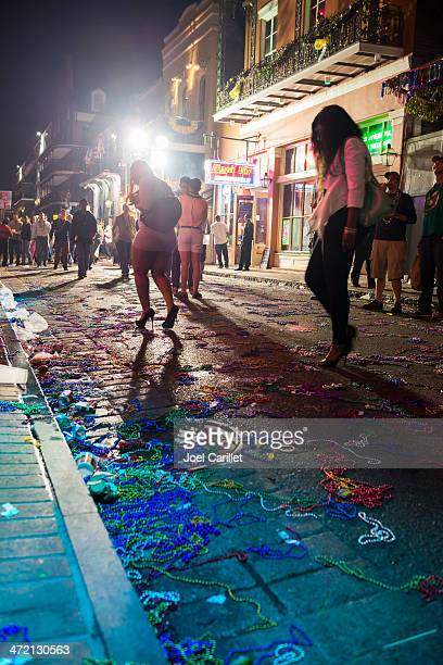 bead-strewn streets at mardi gras - mardi gras beads stock photos and pictures