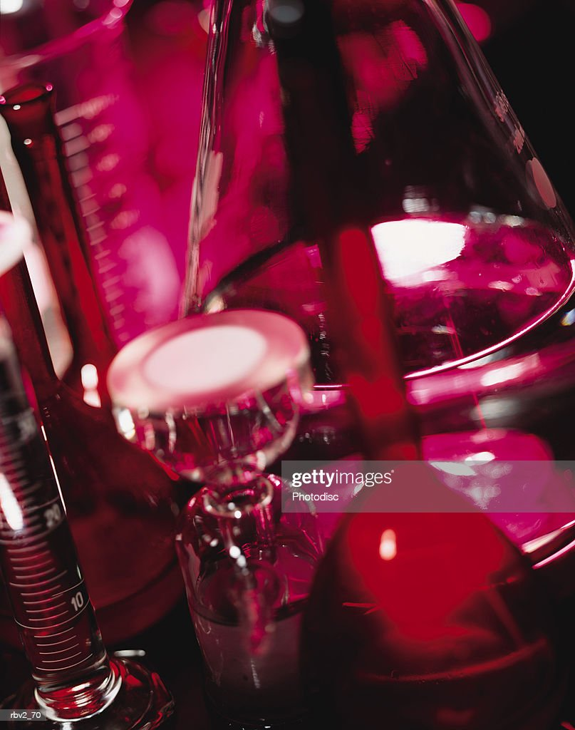 beakers and scales clutter a table in a science lab : Foto de stock