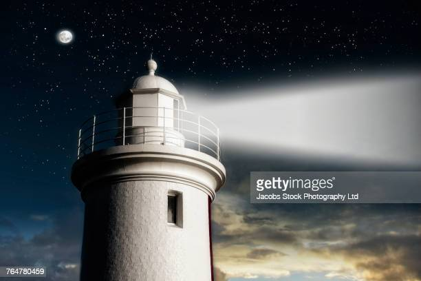 beam of light from lighthouse at night - launceston australia stock pictures, royalty-free photos & images