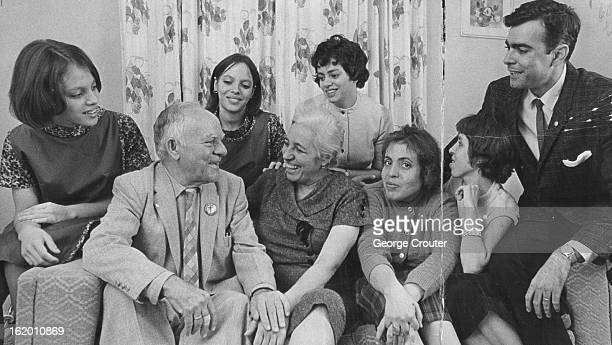 DEC 9 1965 DEC 10 1965 Beaming Happily Mr and Mrs Antonio Lezcano front Row Chat with Family Others left to right are twin daughters Silvia and...