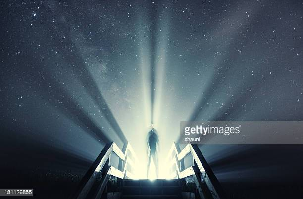 beaming light under the stars - spotlit stock pictures, royalty-free photos & images