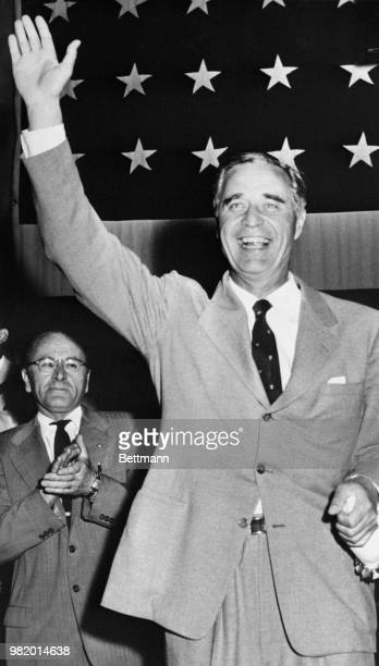 Beaming United States Senator Prescott Bush waves during applause from delegates after his nomination for another term, at the Republican State...