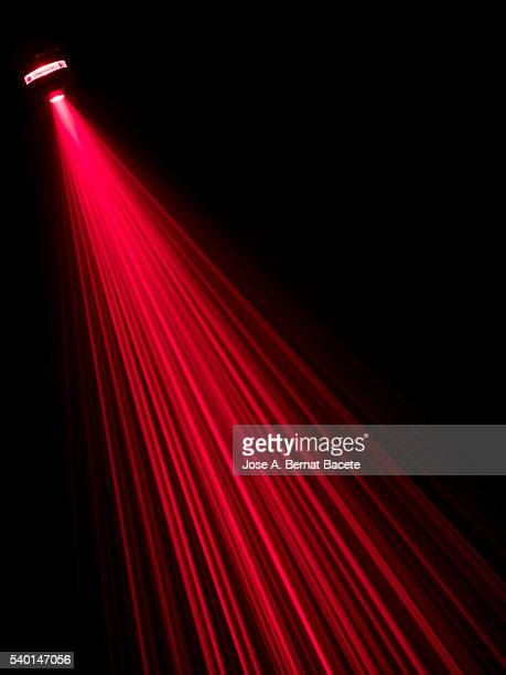 Beams laser of red color on a surface of black color