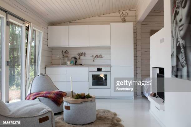 Beanbag chairs sit in the seating and kitchen area of a guest cabin on SuperShe island near Raasepori, Finland, on Wednesday, June 27, 2018. The...