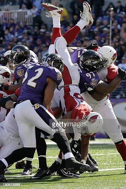 Beanie Wells of the Arizona Cardinals dives over the Baltimore Ravens defense for a first half touchdown at M&T Bank Stadium on October 30, 2011 in...