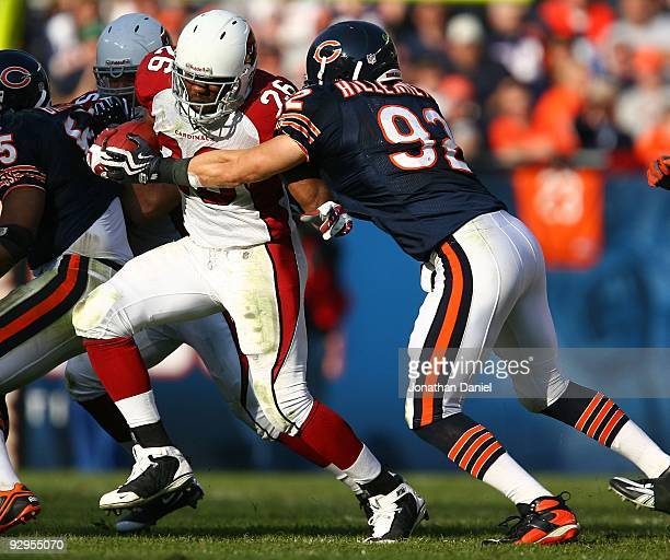 Beanie Wells of the Arizona Cardinals is grabbed by Hunter Hillenmeyer of the Chicago Bears at Soldier Field on November 8 2009 in Chicago Illinois...