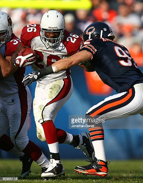 Beanie Wells of the Arizona Cardinals is hit by Hunter Hillenmeyer of the Chicago Bears at Soldier Field on November 8 2009 in Chicago Illinois The...