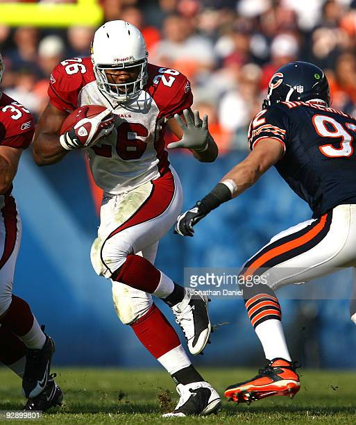 Beanie Wells of the Arizona Cardinals runs against Hunter Hillenmeyer of the Chicago Bears at Soldier Field on November 8 2009 in Chicago Illinois...