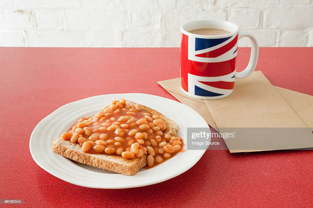 Beans on toast and tea : Stock Photo