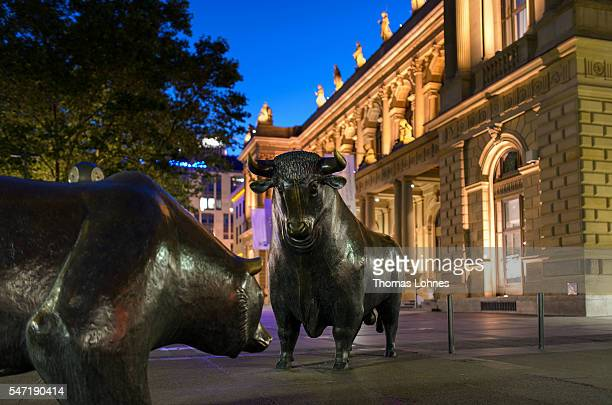 Bear and a bull statue stand illuminated at night outside the Frankfurt Stock Exchange on June 26, 2016 in Frankfurt, Germany. The city of Frankfurt...