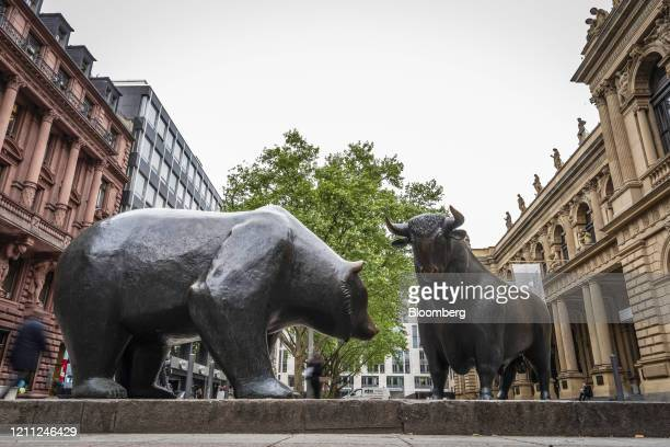 Bear and a bull statue stand outside the Frankfurt Stock Exchange, operated by Deutsche Boerse AG, in Frankfurt, Germany, on Tuesday, April 28, 2020....