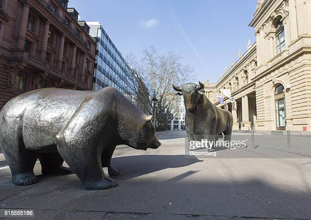 Bear and a bull statue stand outside the Frankfurt Stock Exchange in Frankfurt, Germany, on Monday, March 14, 2016. European stocks have rebounded 13...