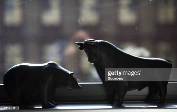 Bear and a bull statues sit on a windowsill following a news conference to announce the Deutsche Boerse AG earnings at the Frankfurt Stock Exchange...