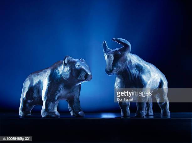 Bear and bull models on blue background