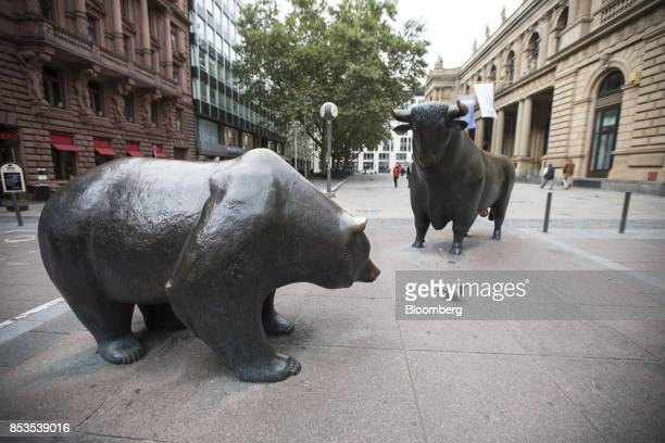 Bear and bull statues stand outside the Frankfurt Stock Exchange operated by Deutsche Boerse AG in Frankfurt Germany on Monday Sept 25 2017 The euro...