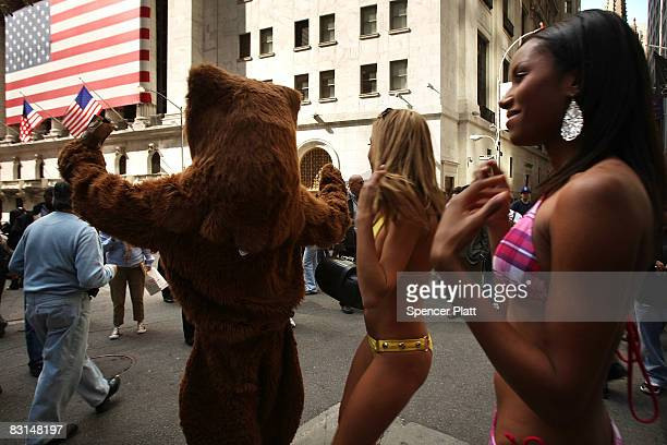 A bear and dancing girls hired by the group Barley Political perform in front of the New York Stock Exchange in an effort to make comedy out of the...