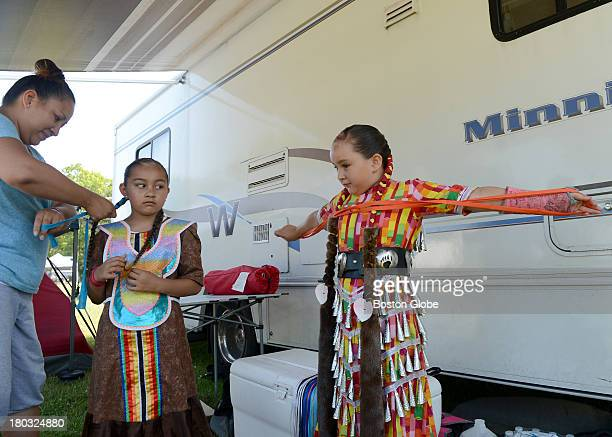 Bear Bear Laughing from Akwesasne NY left helps her daughters Noelani Wilson center and Isabelle Wilson prepare to take part in the 92nd Mashpee...