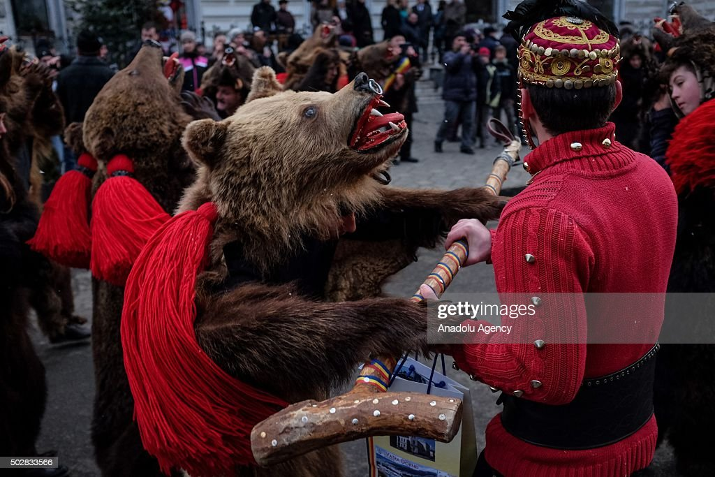 A bear costume worn performer dances during a traditional dance festival in Vatra Dornei, Romania, on December 29, 2015.