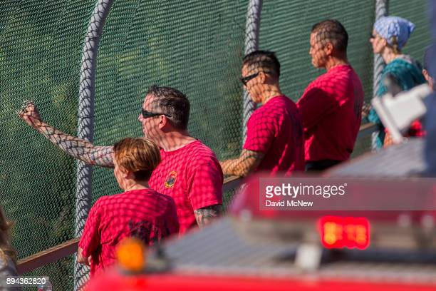 Bear Divide Hotshots firefighters watch for the approach of a procession carrying the body of Cory Iverson a fire engineer for Cal Fire San Diego who...