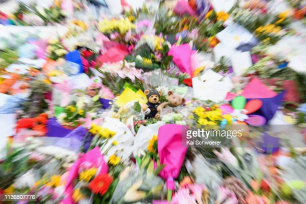 A bear dressed in an All Blacks Rugby shirt is seen amongst flowers and condolences in front of Linwood mosque on March 18 2019 in Christchurch New...