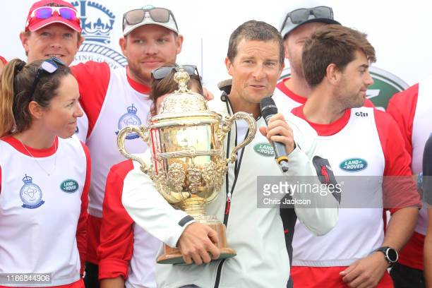 Bear Grylls and his crew competing on behalf of Tusk are presented with the Kings Cup after winning the inaugural King's Cup regatta hosted by the...