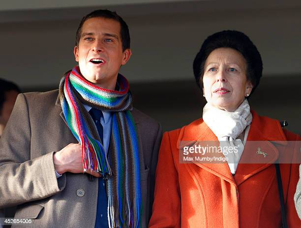Bear Grylls and Princess Anne The Princess Royal watch the racing as they attend the Hennessy Gold Cup Race Day at Newbury Racecourse on November 30...
