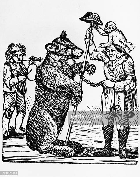 A bear in a muzzle 'dances' to the tune of its owner while a monkey capers on another man's shoulders circa 1800 An engraving by Thomas Bewick