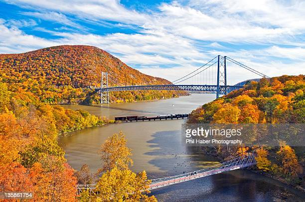 bear mountain bridge on peak fall colors - phil haber stock pictures, royalty-free photos & images