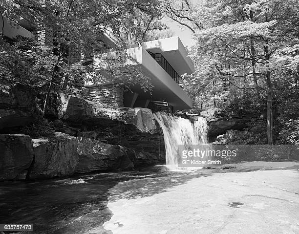 """Bear Run, Pennsylvania, USA- View of the waterfall and exterior of Frank Lloyd Wright's """"Falling Water,"""" built in Bear Run, Pennsylvania in 1937 for..."""