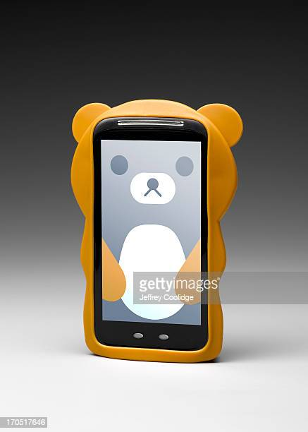 bear smart phone - phone cover stock pictures, royalty-free photos & images