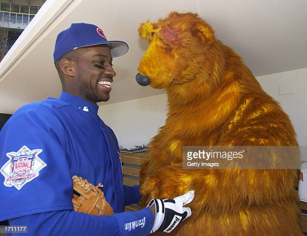 Bear the star of Jim Henson's Bear in the Big Blue House visits Chicago Cubs first baseman Fred McGriff before a game against the Los Angeles Dodgers...