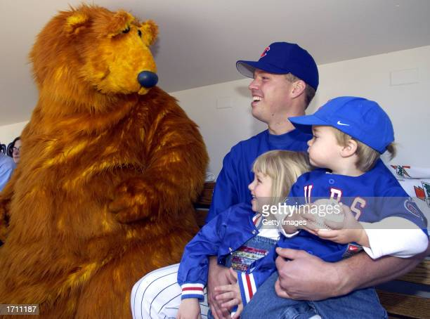 Bear the star of Jim Henson's Bear in the Big Blue House visits in the dugout with Chicago Cubs pitcher Jon Lieber his daughter Jillian and son Jared...