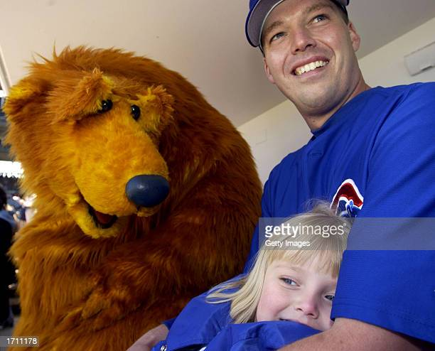Bear the star of Jim Henson's Bear in the Big Blue House visits with Chicago Cubs pitcher Jon Lieber and his daughter Jillian before a game against...