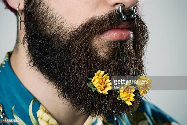 beard with flowers - fake man stock photos and pictures