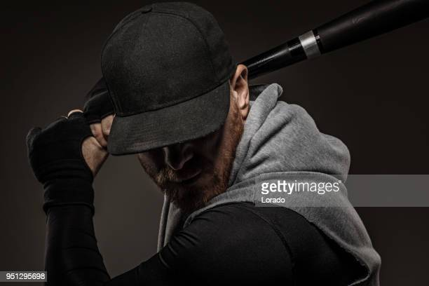 bearded aggressive redhead adult man baseball player holding a baseball bat - baseball cap stock pictures, royalty-free photos & images