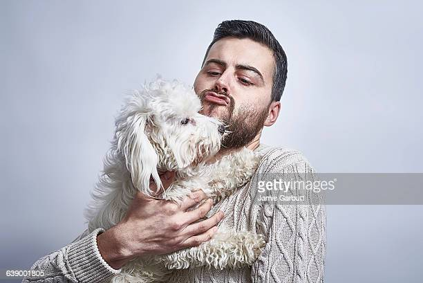 bearded british male with his dog - dogs stock photos and pictures