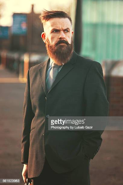 Bearded businessman looking ahead