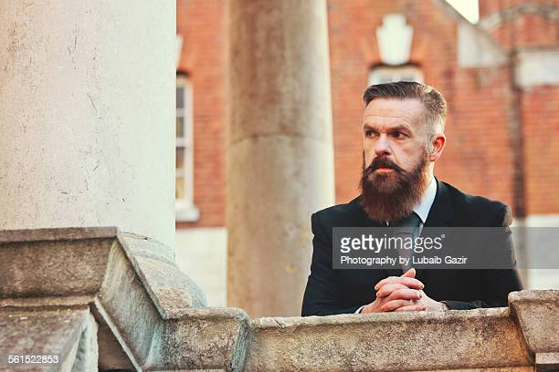 Bearded businessman looking sidewards