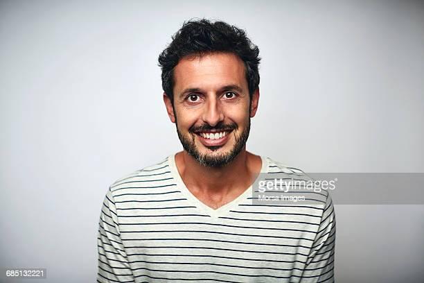 bearded businessman smiling over white background - cabelo preto imagens e fotografias de stock
