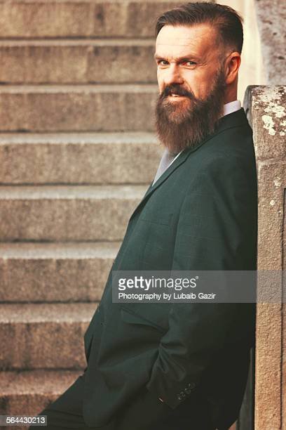 Bearded businessman smiling