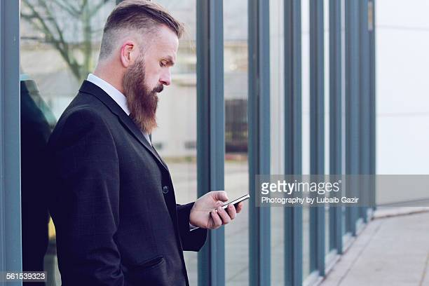 Bearded Businessman texting